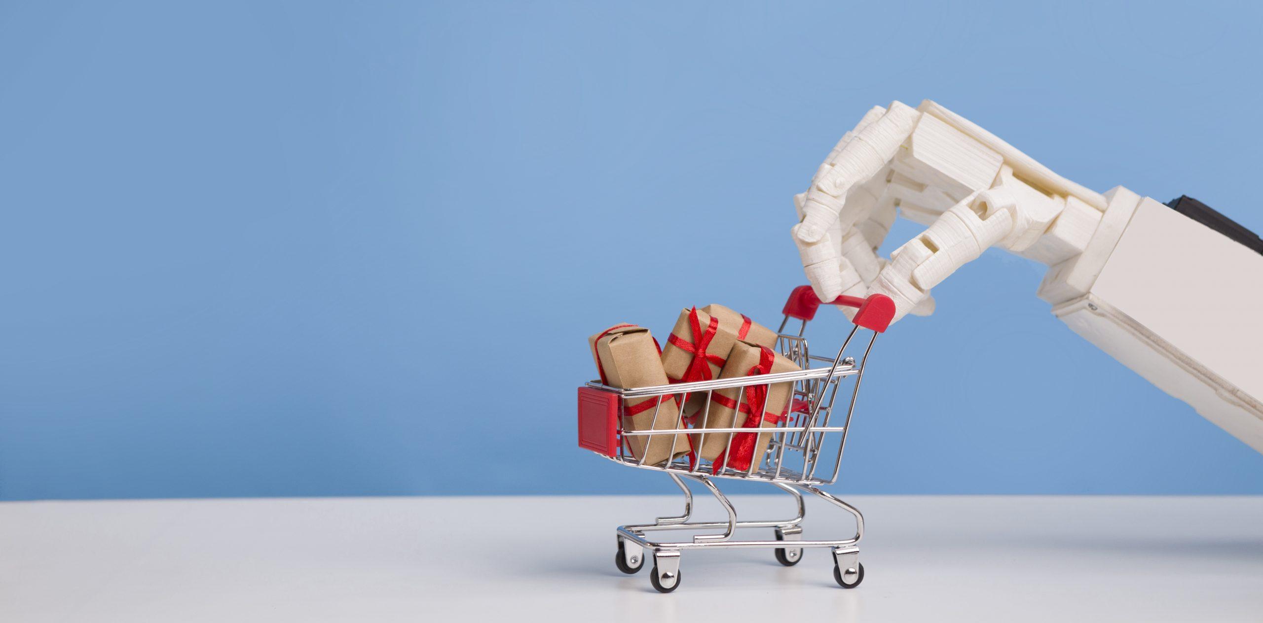 Mano de robot llevando un carrito de la compra. Las automatizaciones en marketing inducen a aumentar las ventas sin la intervención humana.